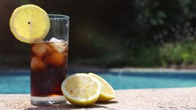 Soft drink on the pool. Holiday by the pool with a soft drink stock video footage