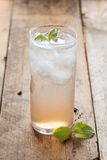 Soft drink strawberry soda and ice cube. Royalty Free Stock Images