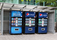 Soft drink vending machine. Three vending machines of Pepsi Aquafina and other soft drinks Stock Image