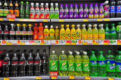 Soft drinks. And beverages on shelves at a supermarket in hong kong Stock Photography