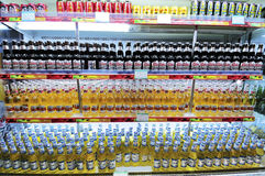 Soft drinks,beer. Soft drinks and beer lined up in a shelf of a store Stock Photos