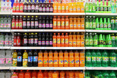 Soft Drinks And Beverages In Supermarket. Beverages and soft Drinks in China supermarket shelf Royalty Free Stock Photo
