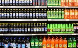 Soft Drinks And Beverages In Supermarket. Beverages and soft Drinks in China supermarket shelf Stock Images