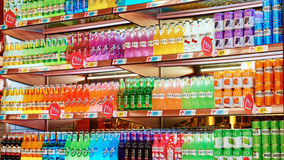 Soft drinks and beverages in supermarket. Shelf Stock Image