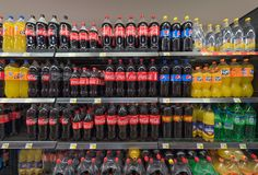 Soft drinks and beverages in supermarket. Variety of soft drinks and beverages on the shelves for sale in a supermarket, Croatia, 2017 Stock Image