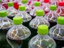 Soft drinks in bottles. Soda soft drinks in bottles in supermarket Royalty Free Stock Images