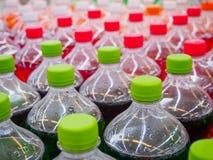 Soft drinks in bottles. Soda soft drinks in bottles in supermarket Royalty Free Stock Photos