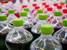 Soft drinks in bottles. Soda soft drinks in bottles in supermarket Stock Photos