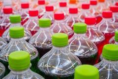 Soft drinks in bottles. Soda soft drinks in bottles in supermarket Stock Images