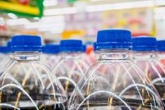 Soft drinks bottles. In supermarket Stock Photos