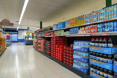 Soft drinks, coca cola and other beverages in supermarket royalty free stock photo