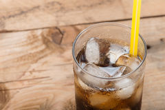 Soft drinks, Cola glass with ice cubes. Royalty Free Stock Images