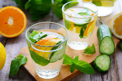 Soft drinks with cucumber, orange and lemon Stock Photography