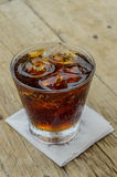 Soft drinks. In glass on the wooden floor Stock Photos
