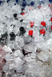 Soft drinks in ice. Royalty Free Stock Photos