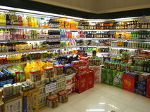 Soft Drinks And Juice In Supermarket. Beverages and soft Drinks in China supermarket shelf Royalty Free Stock Photography