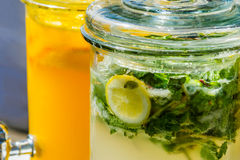 Soft drinks made of lemon, mint and orange Stock Images