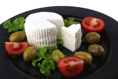 Soft feta cheese served with tomato Stock Photos