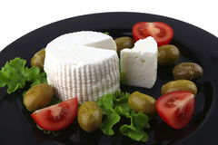 Soft feta cheese served with tomato Royalty Free Stock Photo