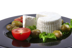 Soft feta cheese served with tomato Royalty Free Stock Image