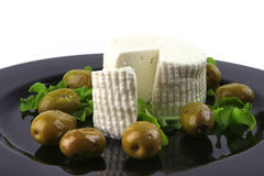Soft feta cheese with tomato olives Royalty Free Stock Images