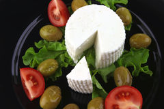 Soft feta cheese with tomato olives Royalty Free Stock Image
