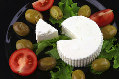 Soft feta cheese with tomato olives Stock Images