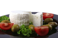 Soft feta cheese with tomato olives Stock Photo