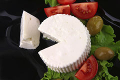 Soft feta cheese with tomatoes Stock Photography