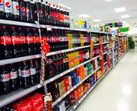 Soft and fizzy drink aisle in Supermarket. Drinks on the shelf at the co-operative supermarket at Oakwood in Leeds Stock Images