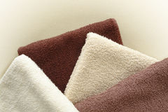 Soft and Fluffy Beige to Brown Cotton Bath Towels royalty free stock photo
