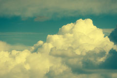 Soft fluffy clouds with vintage effect. Royalty Free Stock Photo