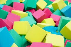 Soft foam cubes. The concept of children`s holiday. Background. Texture stock images