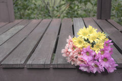 Soft focus and Blur. Bouquet of colorful flowers. Placed on a wooden floor Royalty Free Stock Image