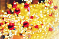 Christmas wallpaper and new year festival. Soft-focus and blurred of gold, red and white glittering shine bulbs lights background.Christmas wallpaper and new Royalty Free Stock Images