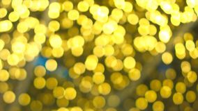 Christmas wallpaper and new year festival. Soft-focus and blurred of gold, red and white glittering shine bulbs lights background.Christmas wallpaper and new Stock Images