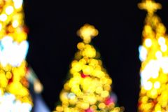 Christmas wallpaper and new year festival. Soft-focus and blurred of gold, red and white glittering shine bulbs lights background.Christmas wallpaper and new Stock Photography