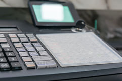 Soft focus Of Cash Register With Printed Receipt Stock Photos
