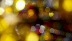 Soft focus christmas lights. Blurred turning colourful lights, with strong bokeh effect stock footage
