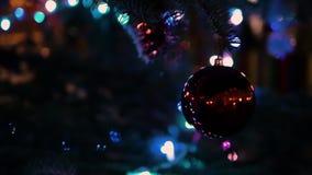 Soft focus Christmas lights, Christmas toy on a Christmas tree branch