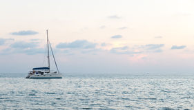 Soft Focus Color Filter of The Sea with Single Yacht at The Corner, Lonely Feeling Royalty Free Stock Images