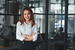Soft focus of confident Asian businesswoman standing in office. Leader business woman concept. Soft focus of confident Asian businesswoman standing in office stock photos