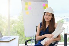 Soft focus of confident engineer woman smiling in workplace of office with sunshine effect. Soft focus of confident engineer woman smiling in workplace of royalty free stock photography