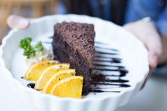 Soft focus delicious Chocolate cake decorated with orange on whi Royalty Free Stock Photography