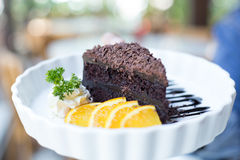 Soft focus delicious Chocolate cake decorated with orange on whi Royalty Free Stock Photos