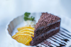 Soft focus delicious Chocolate cake decorated with orange on whi Stock Photography