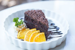 Soft focus delicious Chocolate cake decorated with orange on whi Stock Photo