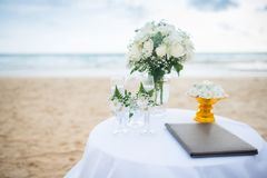Flowers decorate at a wedding ceremony on the beach. royalty free stock photo