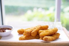 Fried Chicken Crispy Stick on wooden plate. stock image
