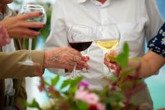 Soft focus at group elderly hands holding wine glass and clink glasses. Concept of older party , retire and superannuate people,. Sixtieth anniversary of age royalty free stock photography
